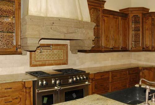Brick Tile Backsplash and Stone Rangehood