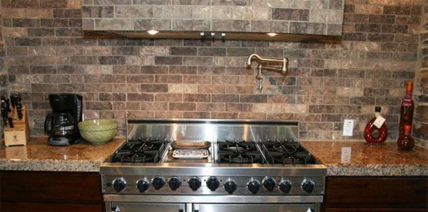 faux brick tile backsplash in the kitchen tile